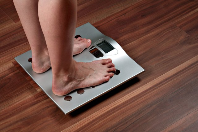 Woman's feet on weight scale