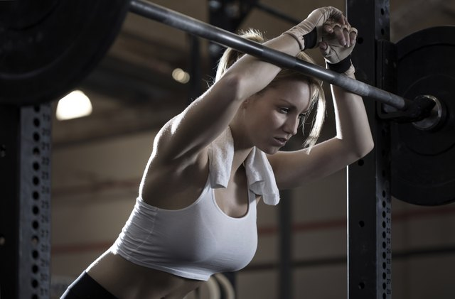 Woman training at crossfit center