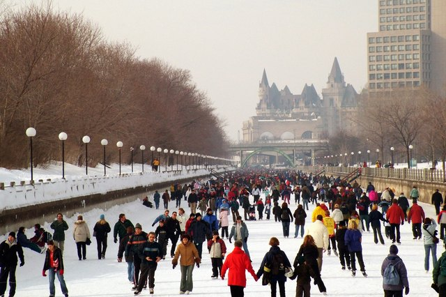 Winterlude skaters on Rideau Canal skate-way, Ottawa Canada.