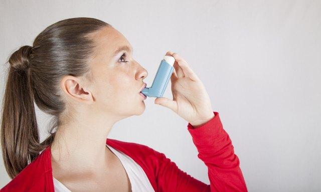 Cute girl with asthma inhaler