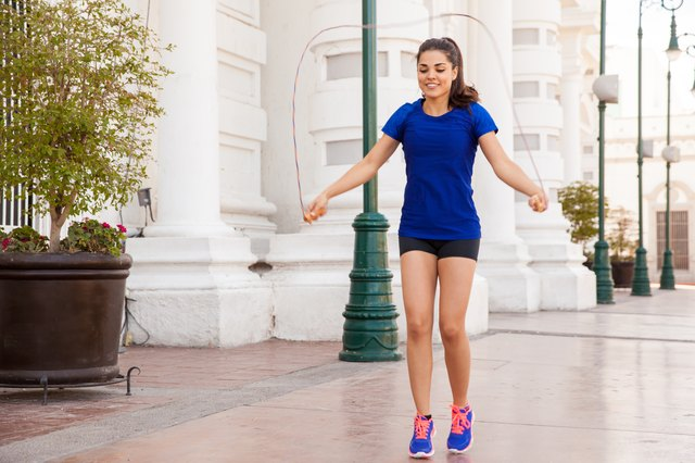 Young woman jumping a rope