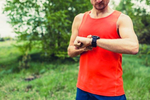 Runner looking at sport smart gps watch