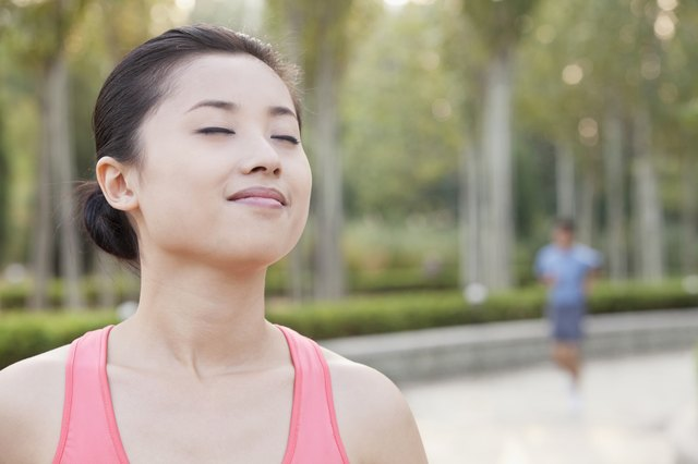 Young Woman With Eyes Closed in Park in Beijing