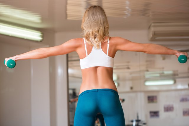 girl engaged in fitness with dumbbells