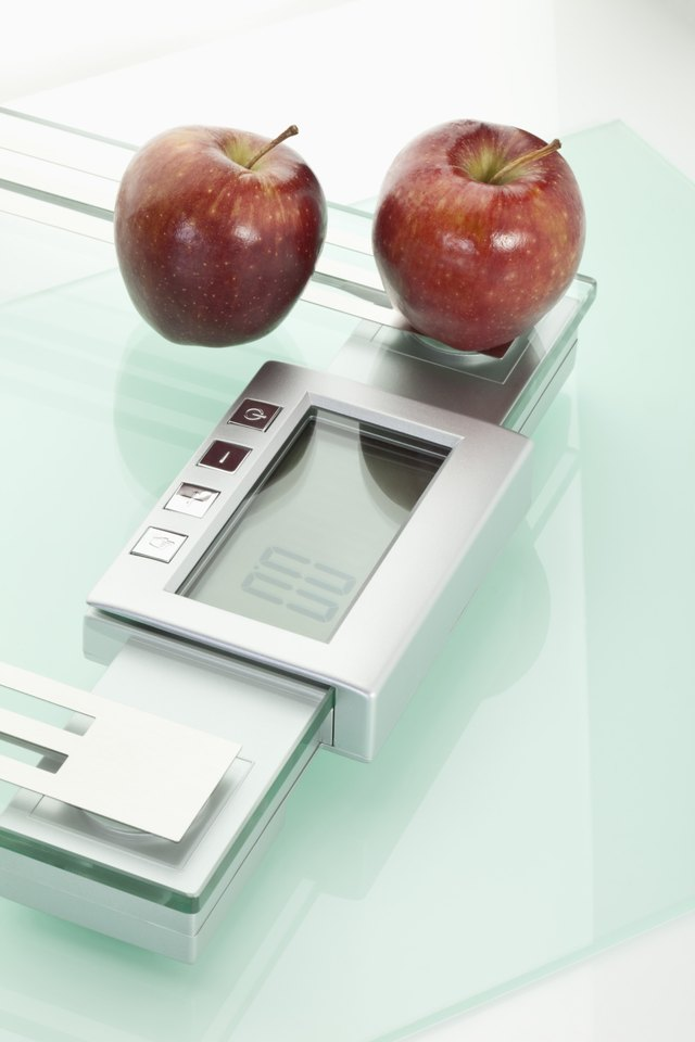 Apples on scales,close up
