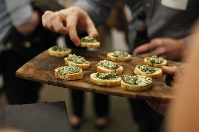 Platter of spinach and artichoke dip served at a party