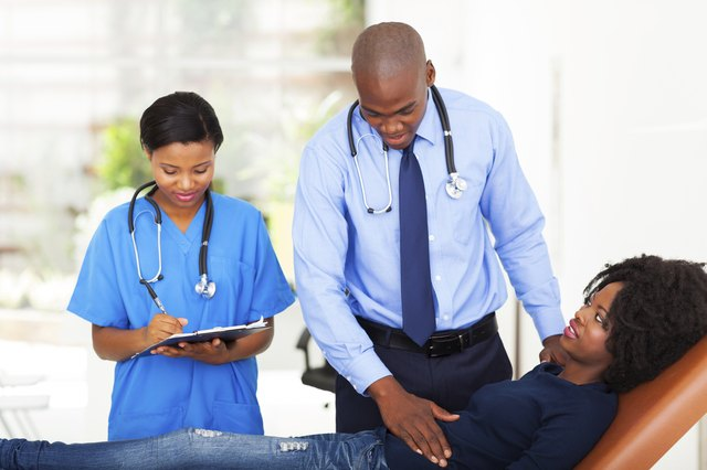 african doctor examining female patient