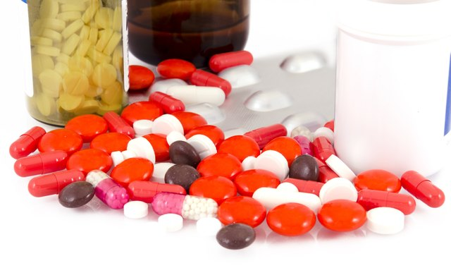 Medicine pills and bottles on a white background