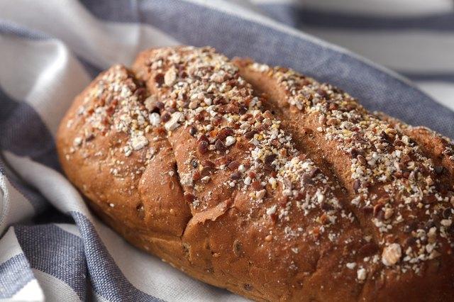 Dark multigrain bread whole grain fresh baked on rustic