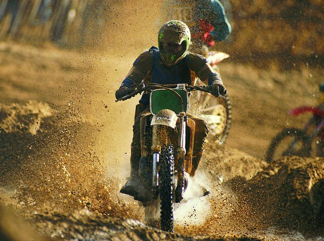 Motorcycle racer on dirt track