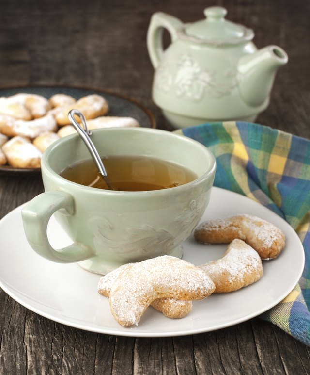 Crescents vanilla almond cookies and cup of green tea
