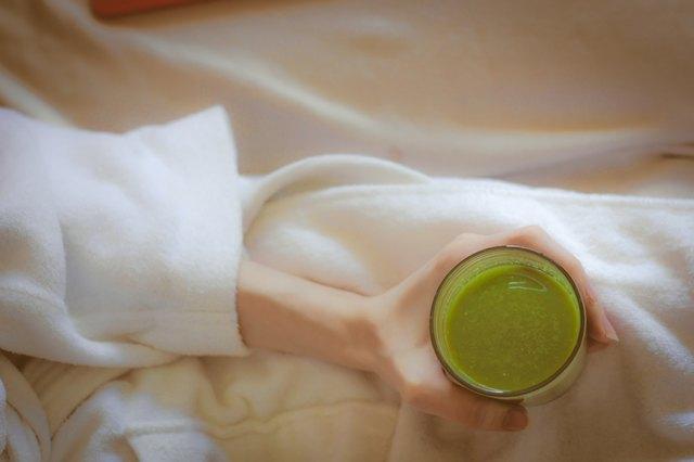 Ariel green smoothies on health spa white robe