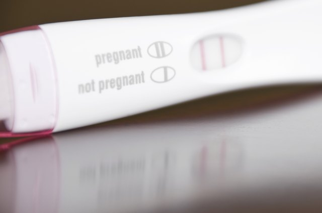Positive Pregnancy Test Close-Up on a Brown Wooden Table