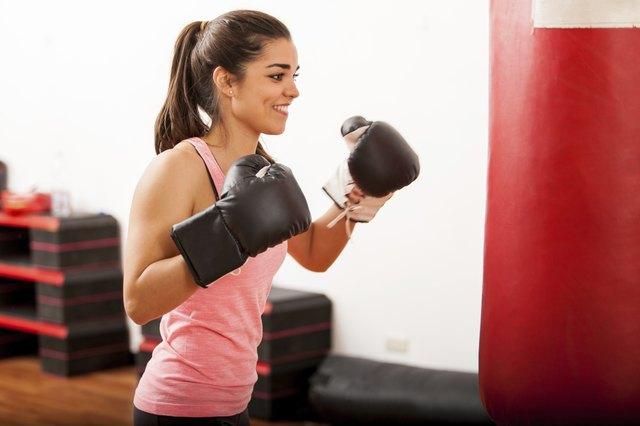 Cute female boxer training in a gym