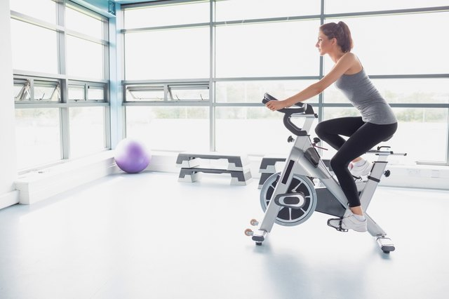 Woman riding an exercise bike