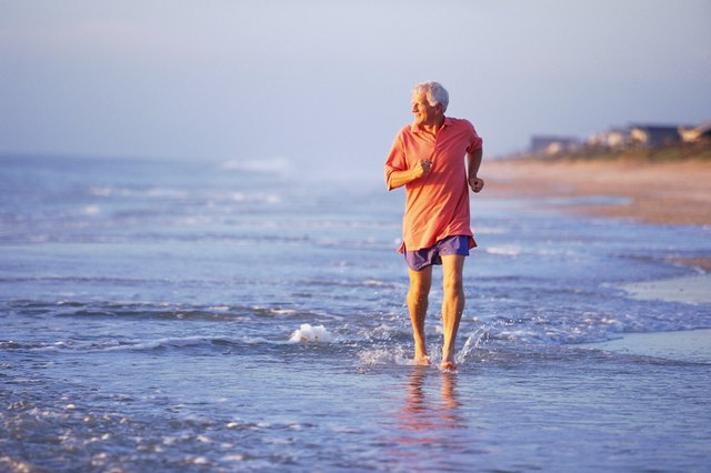 Man jogging in shallow surf