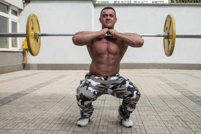 Bodybuilder Doing Front Squats With Barbells