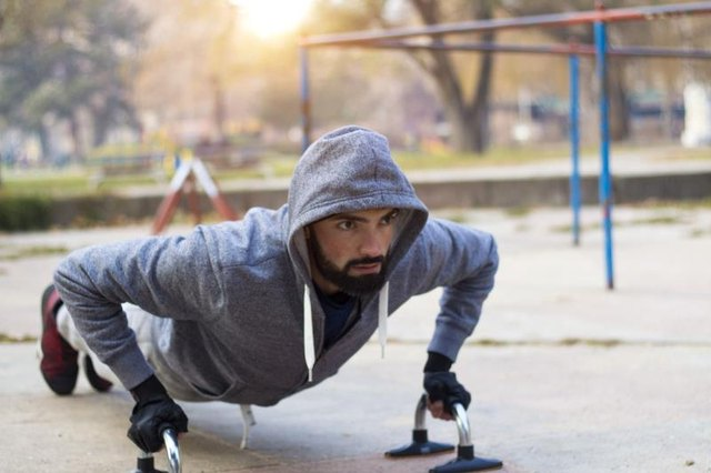 Young athlete working out in an outdoor gym and lead a healthy life