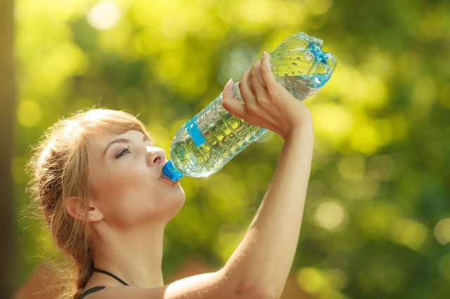Tourist woman with water bottle outdoor