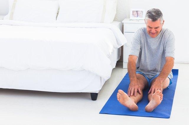 Man working out on an mat