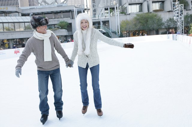 Mature couple ice skating together