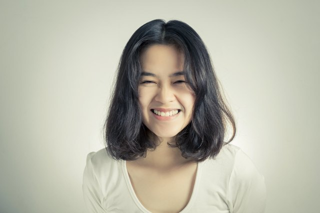 Young Asian woman with smiley face.