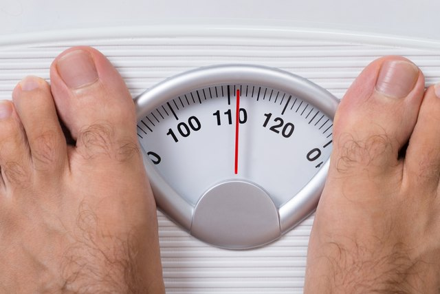 Man's Feet On Weight Scale