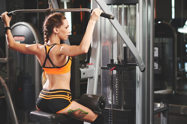 Working out on pulldown machine