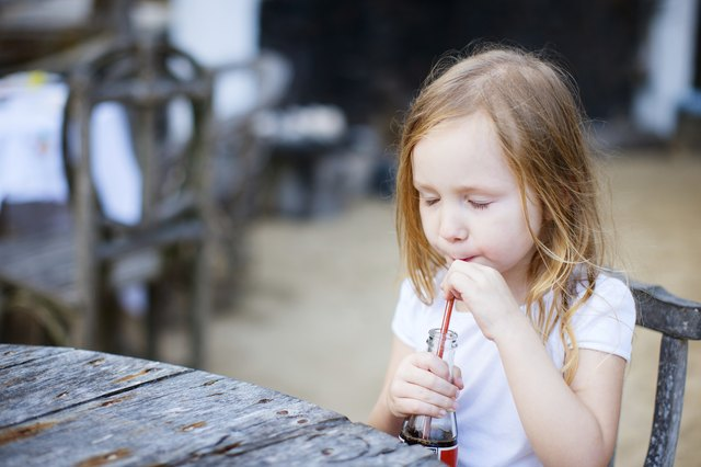 Little girl with a soft drink