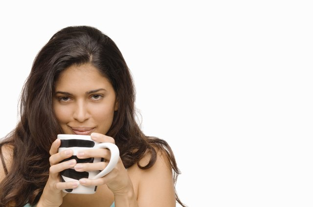 Portrait of a young woman holding a mug of coffee