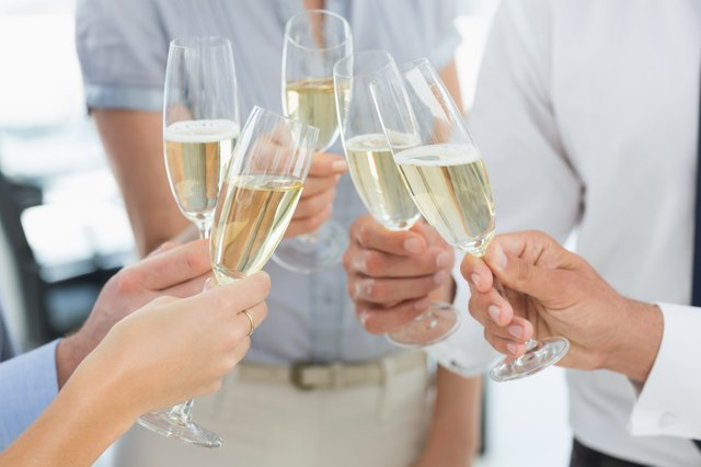 Hands toasting with champagne
