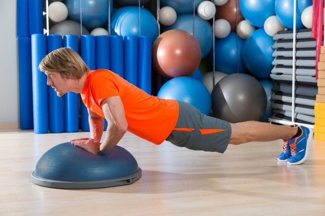 Bosu diamond push up blond man gym exercise