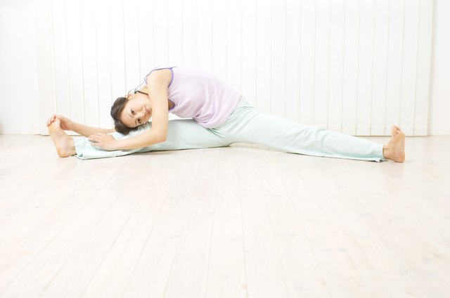 Young woman doing stretches