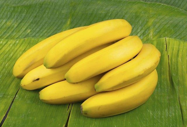 perfect yellow bananas on a banana leaf