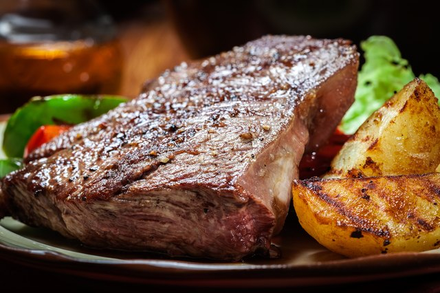 Grilled T-Bone Steak with roasted potato wedges