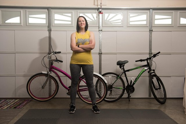 Lacey stands in front of her bikes.
