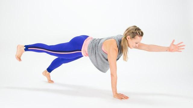 Elise Joan demonstrates the Cross Body Plank