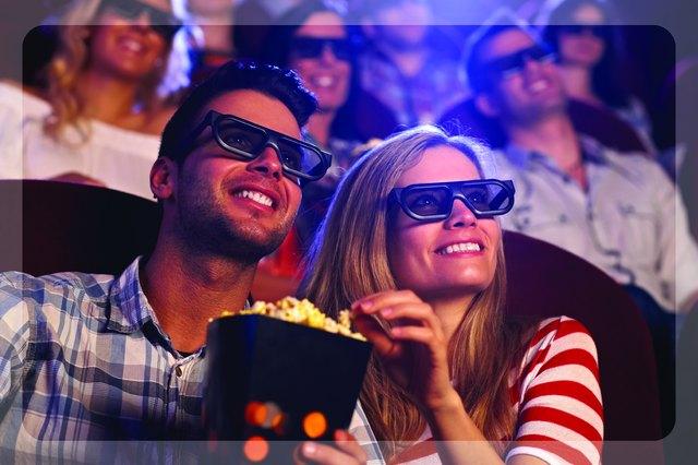 Couple enjoying popcorn at a 3D movie