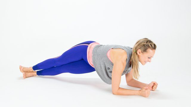 Elise Joan demonstrates the Twisted Hip Dip Plank