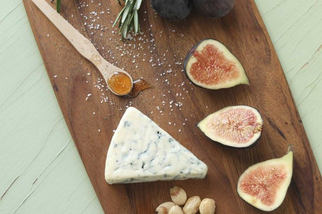 Cheese and figs on a cutting board