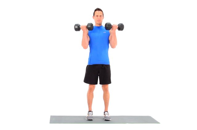 Proper form for a dumbbell curl with a twist.