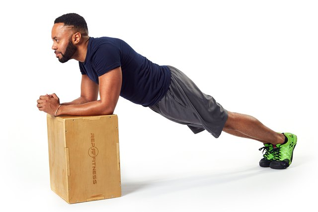 man doing a plank on a box
