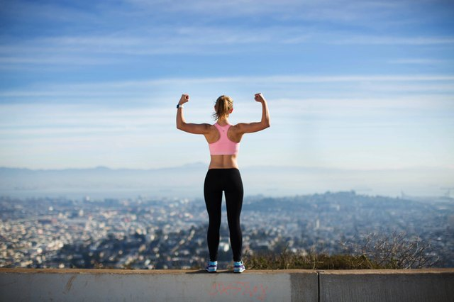 woman flexing overlooking the city
