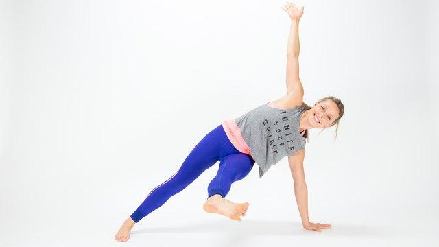 Elise Joan demonstrates the Fallen Triangle Side Plank