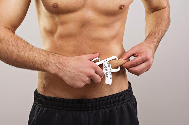 fit man measures body fat