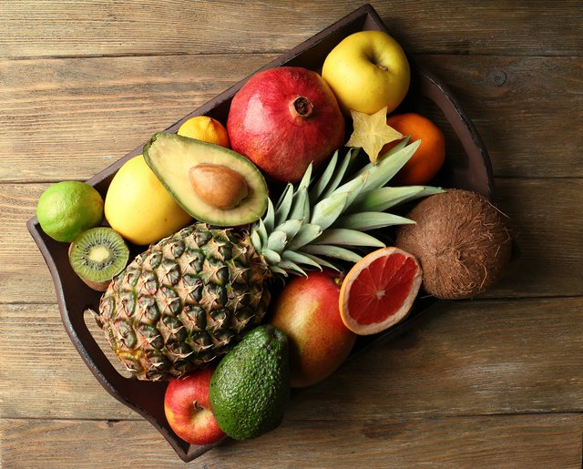 Assortment of fruits on wooden table