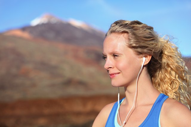 woman hiking listens to music