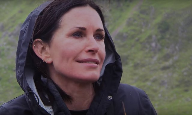 """Courteney Cox speaks to TV host Bear Grylls on the Monday, August 22, 2016, episode of """"Running Wild With Bear Grylls."""""""