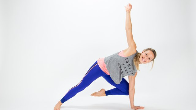 Elise Joan demonstrates the Eye of the Tiger Plank