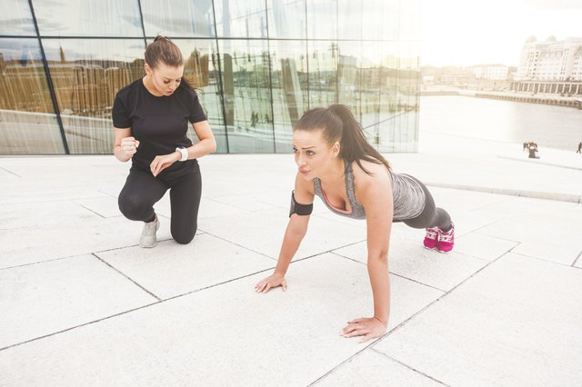 Woman working out with partner.